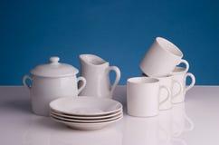 Porcelain coffee cups. Milk jug and sugar pot Royalty Free Stock Photos