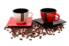 Porcelain coffee mugs with beens Royalty Free Stock Image