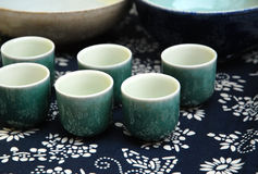 Porcelain cup. S on the table with calico Stock Image