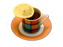 Porcelain cup from coffee and a slice of a lemon. On a white background Royalty Free Stock Images