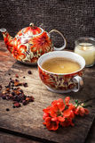 Porcelain cup of fragrant tea for medicinal herbs in retro style. Selective focus.photo tinted Stock Photography