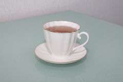 Porcelain Cup with gold tea Royalty Free Stock Image