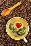 Porcelain cup of hot coffee. Roasted coffee beans. Heart symbol. Food trading. Fair trade coffee. Food photography. Porcelain cup of hot coffee. Roasted coffee stock photography