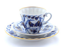 Porcelain cup, plate and saucer on a white background.  Royalty Free Stock Images