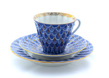 Porcelain cup, plate and saucer on a white background Stock Images