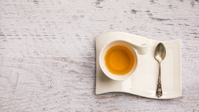 Porcelain cup of tea on vintage background, top view Stock Image