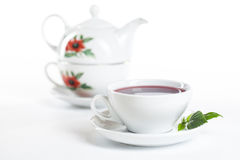 Porcelain cup and teapot Stock Photo