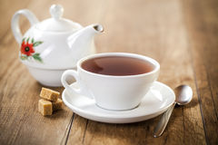 Porcelain cup and teapot Royalty Free Stock Image