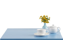 Porcelain cup and teapot on the wooden table Stock Photo