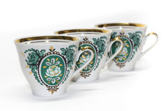 Porcelain cups with a green pattern Stock Photography