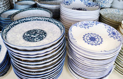 Porcelain dinner-ware. Blue and white Chinese porcelain were made for the Asian markets and in Chinese taste Stock Image