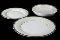 Porcelain dinnerware set serving. Porcelain serving set on black background stock image