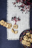 Porcelain dishes and cookies with cranberries Stock Photos