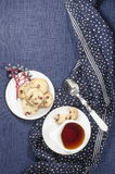 Porcelain dishes and cookies with cranberries Stock Image