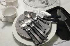 Porcelain Dishes, Plates, Coffee Cup and Silverware Stock Photo