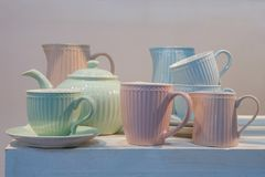 Porcelain dishware for tea. Of green, pink and blue color stock photography