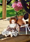 Porcelain doll. Still life with porcelain doll in nature Stock Photo