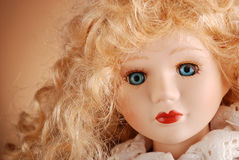 Porcelain doll. With blonde hair and blue eyes Stock Photography