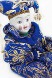 Porcelain doll. With blue and golden clothes Royalty Free Stock Photography