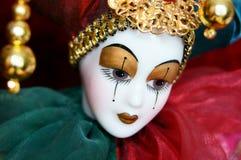 Porcelain doll Arlekino joker Stock Image