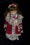 Porcelain Doll on Black Background Stock Photo
