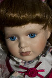 Porcelain Doll on Black Background Royalty Free Stock Photography