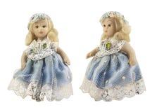 Porcelain doll in blue dress. Stock Image