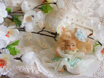 Porcelain doll. In easter decoration Royalty Free Stock Images