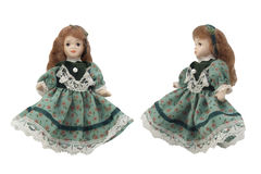 Porcelain doll in green dress. Stock Images