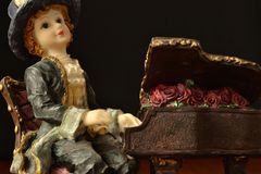 Porcelain doll pianist Royalty Free Stock Photos