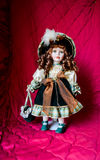 Porcelain doll. On red background Stock Photo
