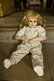 Porcelain Doll on stairs Stock Images
