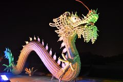A porcelain dragon. Is made up of porcelain plates,cups and spoons. It is a miraculous opus in the Lantern Festival of China stock images