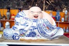 Porcelain figure of Buddha Stock Images