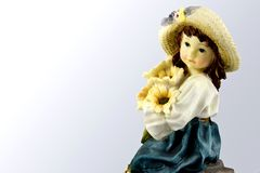Porcelain figure girl with flowers Royalty Free Stock Photo