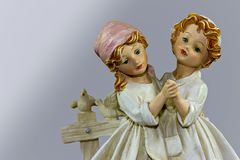 Porcelain figure two sisters dancing Royalty Free Stock Photo
