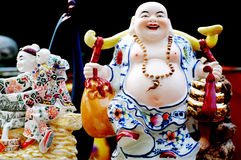 Porcelain figures. Chinese Jindezhen porcelain wares,china figures on display,an artwork dipicting buddhist monk,an arhat.China figurine as an amulet whichi is Royalty Free Stock Images