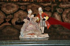 Baroque style porcelain figurine. A porcelain figurine of baroque or rococo style man and woman Royalty Free Stock Image