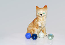 Porcelain figurine. Of a dog who is playing with marbles Royalty Free Stock Images