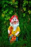Porcelain figurine dwarf Stock Photos