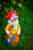 Porcelain figurine dwarf Stock Images
