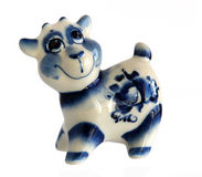 Porcelain figurine of a Merry Cow Royalty Free Stock Image