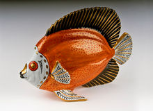 Porcelain Fish. Italian Gilt & Orange Porcelain Fish Sculpture stock photos