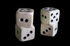 Porcelain gambling dices isolated in black. Stock Images