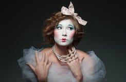Porcelain girl. A girl dressed up as an old vintage porcelain doll Stock Image