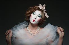 Porcelain girl. A girl dressed up as an old vintage porcelain doll Stock Images