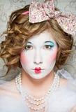 Porcelain girl. A girl dressed up as an old vintage porcelain doll Royalty Free Stock Image