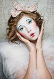 Porcelain girl. A girl dressed up as an old vintage porcelain doll Royalty Free Stock Images