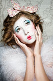 Porcelain girl. A girl dressed up as an old vintage porcelain doll Stock Photos