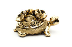 Porcelain golden turtle,  on white background. Royalty Free Stock Image